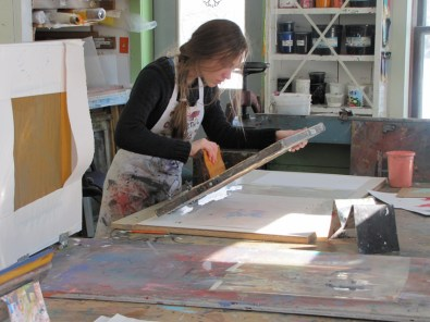 Students work in the silkscreen, papermaking, and intaglio studios