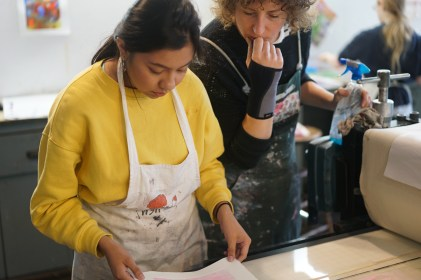 Ewelina Skowronska and one of her students evaluate a print.