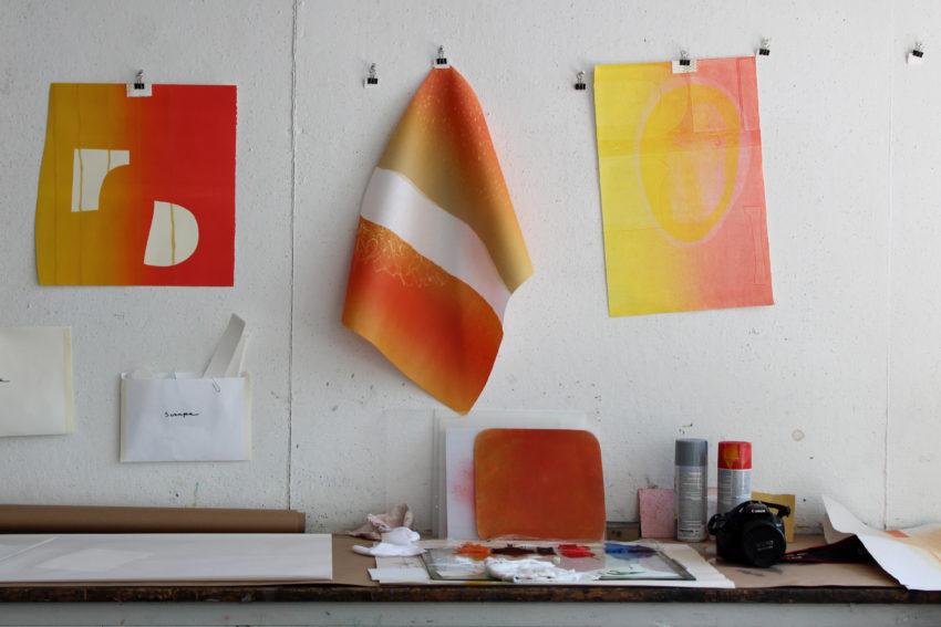 Artist Katie Ford's monoprint work hangs at the Women's Studio Workshop.