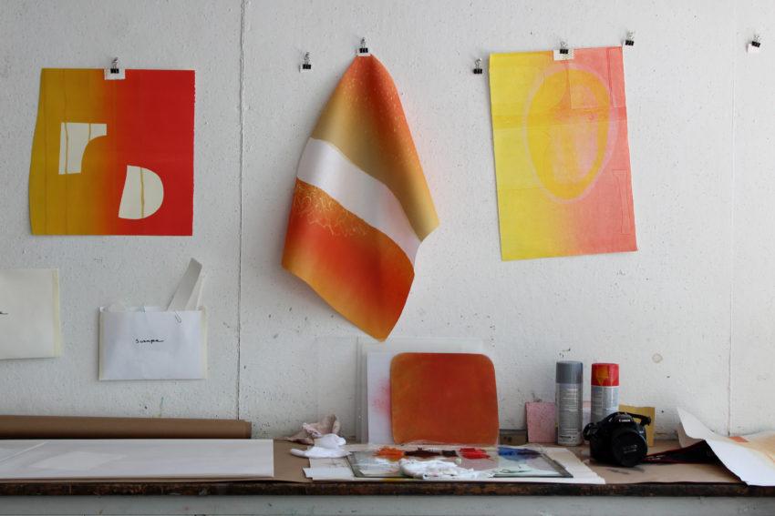 Artist Katie Ford's monoprint work hangs at the Women's Studio Workshop.