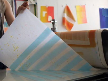 Artist Katie Ford makes a monoprint at the Women's Studio Workshop.