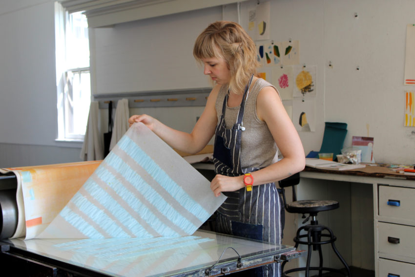 Artist Katie Ford monoprints at the Women's Studio Workshop.