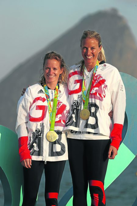 RIO DE JANEIRO, BRAZIL - AUGUST 19: Hannah Mills of Great Britain (left) and Saskia Clark of Great Britain pose with their gold medals after winning the womens 470 class medal race at the Marina da Gloria on Day 14 of the 2016 Rio Olympic Games on August 19, 2016 in Rio de Janeiro, Brazil. (Photo by Clive Mason/Getty Images)