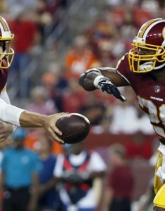 Broncos redskins football washington quarterback alex smith hands the ball off to running back adrian peterson during first also impresses in debut vs wtop rh