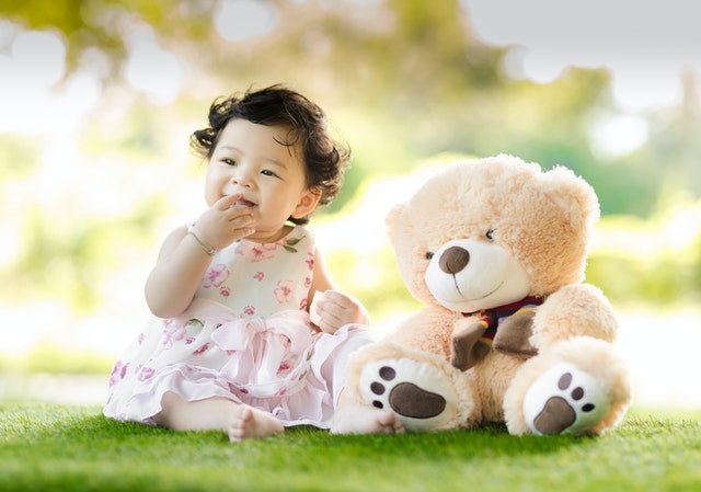 Cute little girl playing with teddy image for girls whatsapp dp