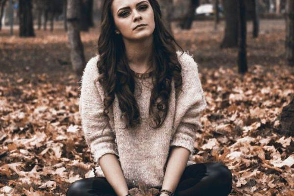 Sad lonely girl sitting in the forest image for whatsapp dp