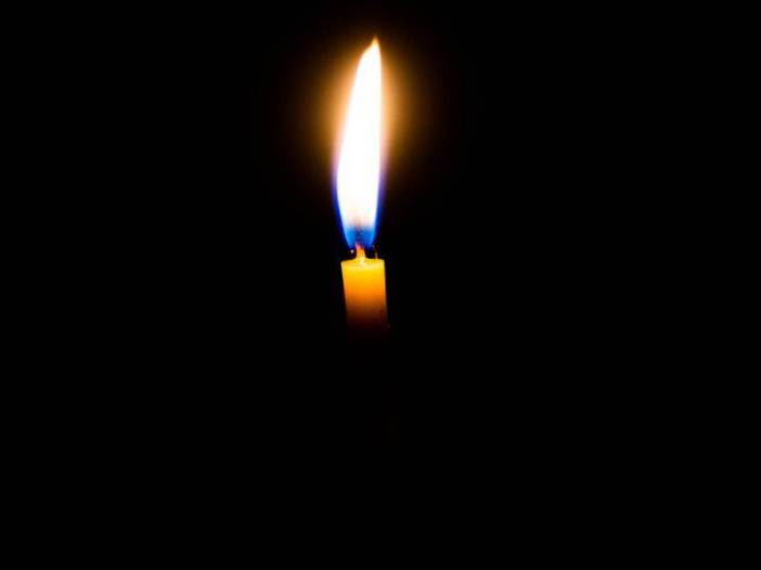 Candle in dark background image for sad whatsapp dp