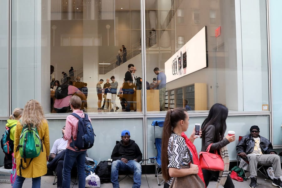 Loyal Apple Customers waiting outside Apple stores in New York to buy the new Apple X