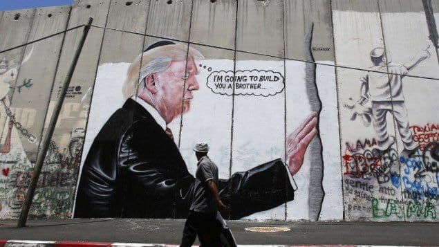 """Graffiti on West Bank barrier shows Trump wearing a skullcap, saying """"I'm going to build you a brother"""