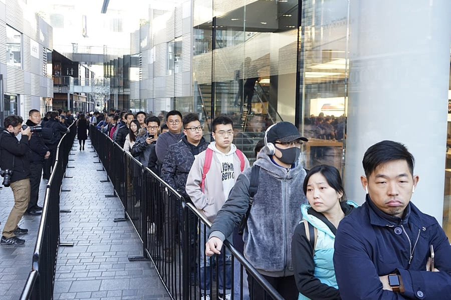 Loyal Apple Customers waiting outside Apple stores in Beijing to buy the new Apple X