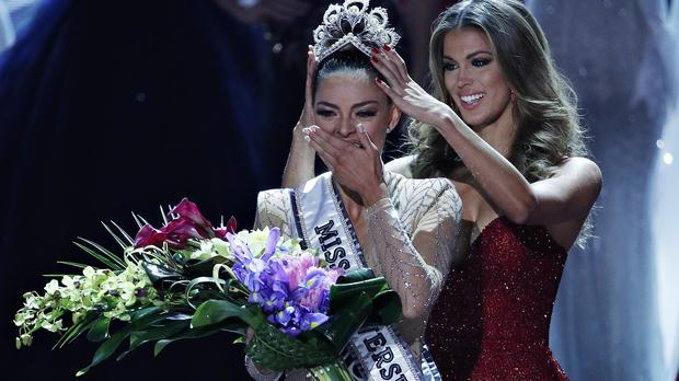 Former Miss Universe Iris Mittenaere, right, crowns new Miss Universe Demi-Leigh Nel-Peters at the Miss Universe pageant Sunday