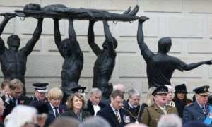 Nation wide respect: A two-minute silence is observed at the National Memorial Arboretum in Staffordshire