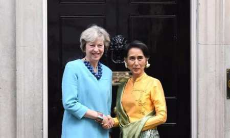 British Prime Minister Theresa May greets Burmese leader Aung San Suu Kyi outside 10 Downing street