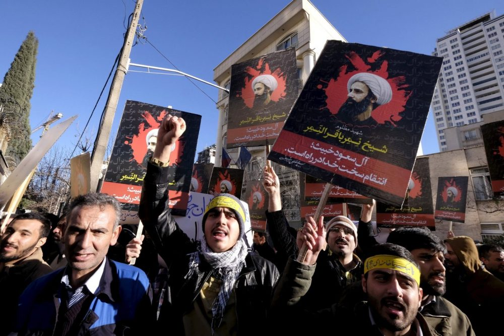 Iranian protesters chant slogans as they hold pictures of Shi'ite cleric Sheikh Nimr al-Nimr during a demonstration against the execution of Nimr in Saudi Arabia, outside the Saudi Arabian Embassy in Tehran