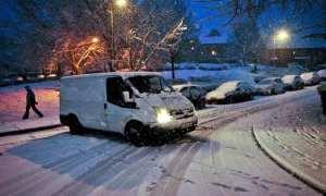 Snow weather postman UK travel disruption across the UK