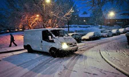 Snow weather postman UK travel disruption across the UK