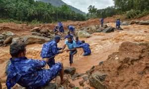Kerala: Rescue workers search for the bodies of missing persons after a landslide, triggered by heavy rains and floods