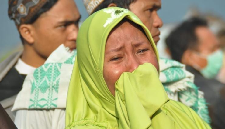 Indonesia earthquake and a tsunami: Rescuers scrambled to reach tsunami-hit central Indonesia and assess the damage