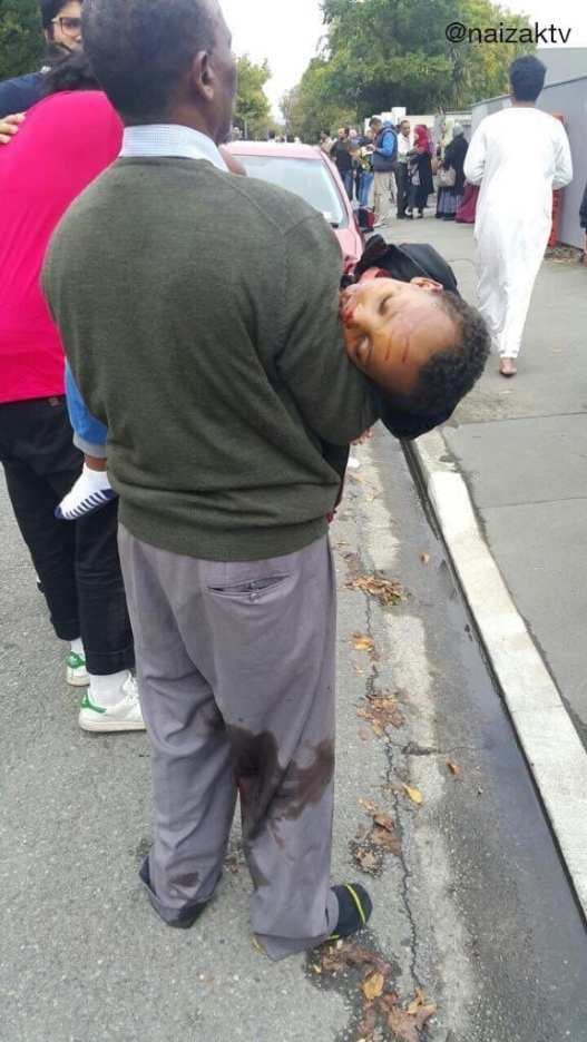 A child in the arms of his father after the newzealand shootings