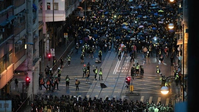 Protesters form a barrier in a standoff against the police, as they confront with police in Hong Kong