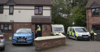 A woman has been arrested after the body of a 10 year old boy was found in a caravan