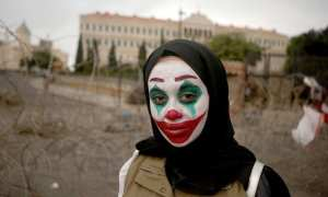 Joker makeup being worn at protests worldwide