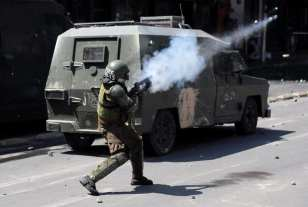 Chilean state of emergency extended around country after deadly riots