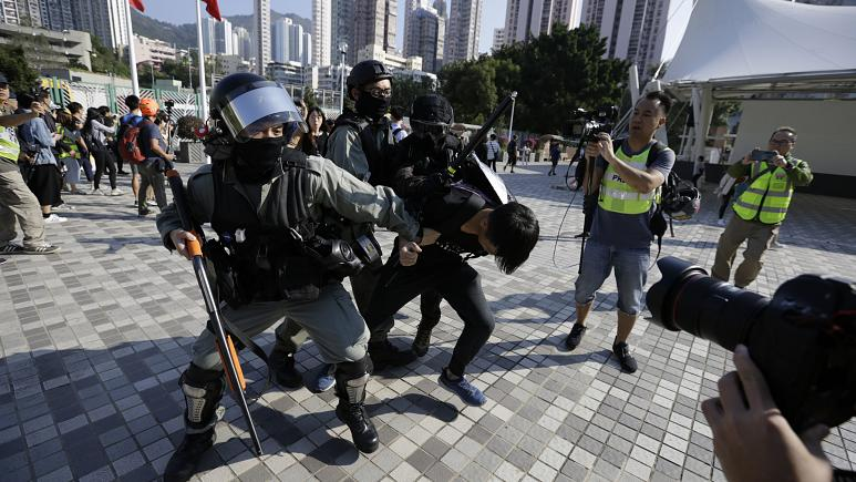 Hong-Kong-protests-erupt as police shoot protester in the street