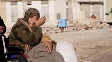 woman forced to flee - Idlib