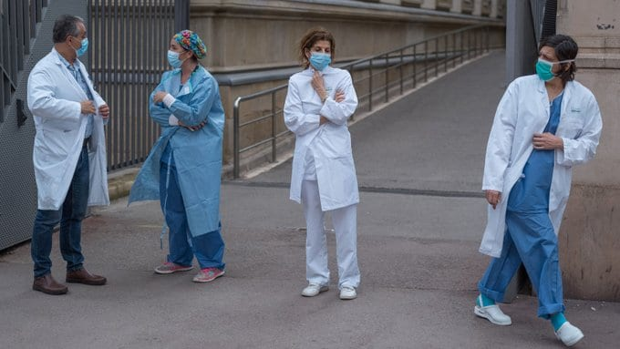 Spain's coronavirus death toll overtook that of China - Hospitals overrun with patients lying on the streets