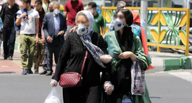 Iran accused of hiding Covid-19 deaths as police arrest 320 for spreading rumours