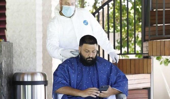 DJ Khaled 'the new norm' Hazmat suit to have haircut