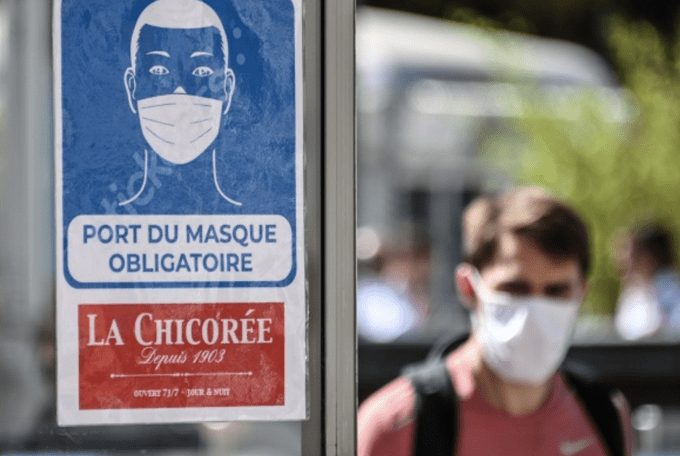 Nations tighten mask rules, lockdowns as Covid-19 deaths approached 700,000