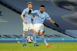 Riyad Mahrez scores for Manchester City against Wolves in Tuesday's Premier League fixture