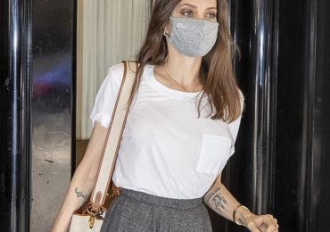 Angelina Jolie shows off cryptic new tattoo 'and yet it moves'