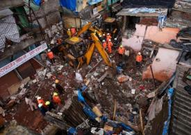 Eight children among 11 killed in horror building collapse 'caused by heavy rain'