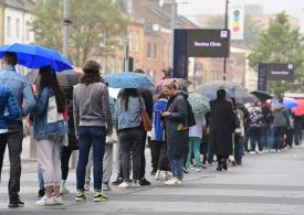 Thousands queue in the rain to get vaccinated as over-18s given jab