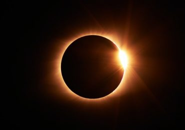 What time is today's partial solar eclipse and how can I see it?