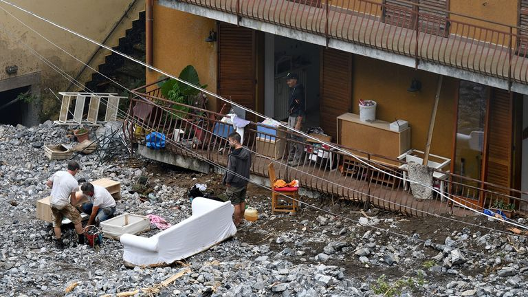 Italy flooding: Dozens rescued amid landslides and heavy rain