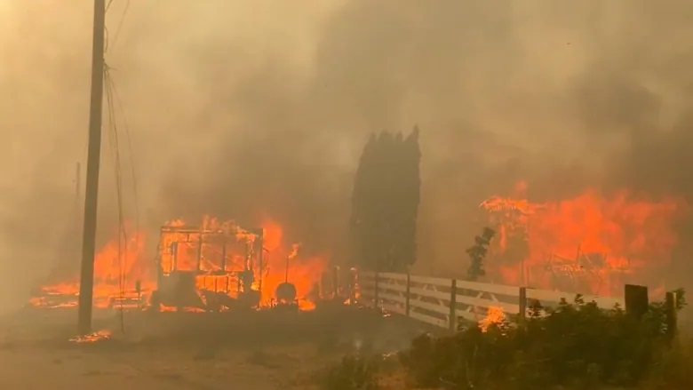 Wildfire in Canada British Columbia heat wave ravages local village. As once again, climate change 2021 shows its devastating impact once..