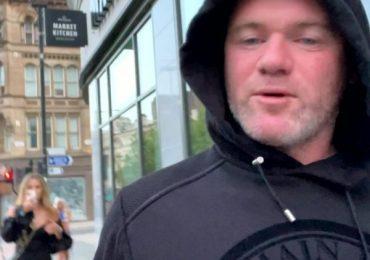 Wayne Rooney filmed walking two blondes back to budget hotel