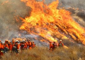 Major US wildfire grows, forces more residents to flee