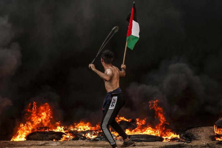 Dozens hurt as Israel raids Gaza, fires at Palestinian protesters