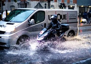 Tower Bridge flooded as torrential rain batters London