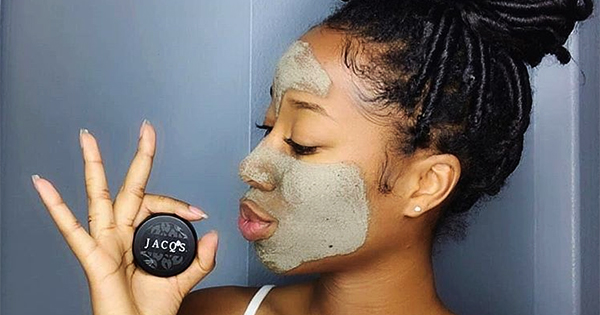 Woman using Black-owned skincare products
