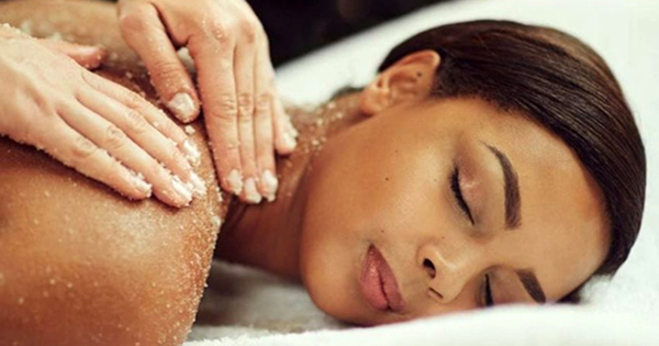 Woman getting a massage at a Black-owned spa