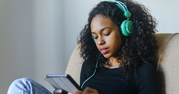 African American listening to business podcast