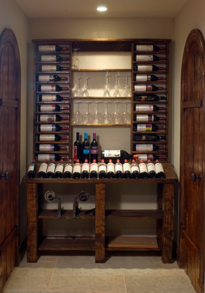 WunderWoods stained hand hewn white pine wine cellar Mouton Rothschild display