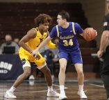 SIOUX FALLS, SD - NOVEMBER 25: Alex Arians #34 of the South Dakota State Jackrabbits looks past Miles McBride #4 of the West Virginia Mountaineers during the Bad Boy Mowers Crossover Classic at the Sanford Pentagon in Sioux Falls, SD. (Photo by Richard Carlson/Inertia)