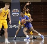 SIOUX FALLS, SD - NOVEMBER 25: Douglas Wilson #35 of the South Dakota State Jackrabbits drives into Derek Culver #1 of the West Virginia Mountaineers during the Bad Boy Mowers Crossover Classic at the Sanford Pentagon in Sioux Falls, SD. (Photo by Richard Carlson/Inertia)